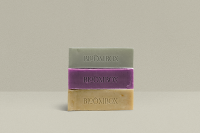 Bloombox soap stack in green, purple, and natural tones