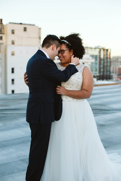 couple-embraces-at-The-Lafayette-Building-in-Little-Rock