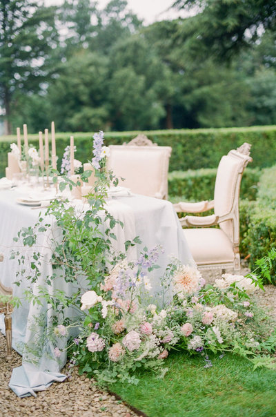 Wedding table with flowers overflowing and running down to the ground