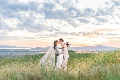 bride and groom at sunset on top of ensign peak in salt lake city