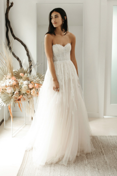 Sweetheart ball gown with feather motif lace placed on bodice and strategically trickling down the skirt from the waistline, scattered clear sequins, and finished off at the waist with a velvet ribbon.