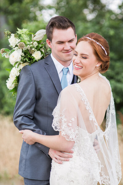 Red head bride in cape dress smitten over groom