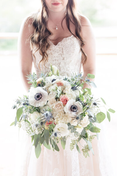 Bridal bouquet with blue thistles at wedding in Phoenix