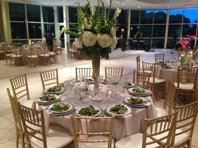 Pre-set salads and elaborate  centerpieces for this luxury affair