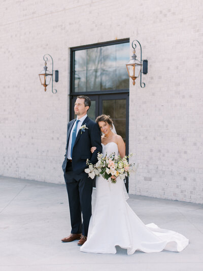 newlywed couple on patio at outdoor wedding venue