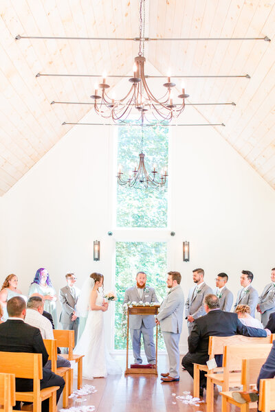 A photo of a couple's wedding ceremony at Juliette Chapel in Dahlonega Georgia by Jennifer Marie Studios.