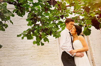 Kissing wedding photograph taken at the walled garden Beeston Fileds