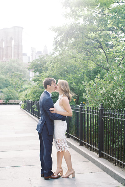Romantic engagement session with Kelsey and Max next to the Brooklyn Bridge in DUMBO.