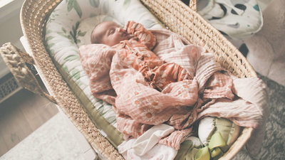Newborn-Baby-Girl-Asleep-in-Cradle