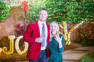 A newly engaged couple show off the ring at Main Street Heritage Park, Wauchula, Florida.