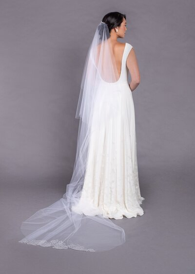 Model wears the Orchids cathedral-length veil with blusher