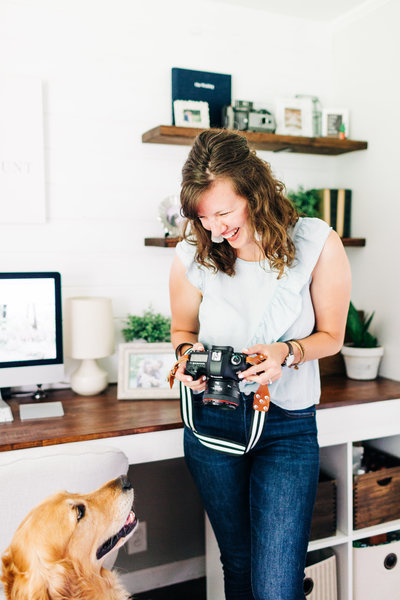 Victoria Hunt posing with her camera in her Indiana photography office