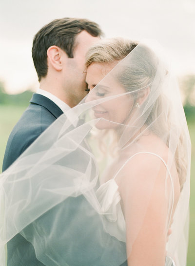Bride and Groom under veil at Daniel Island Club Wedding