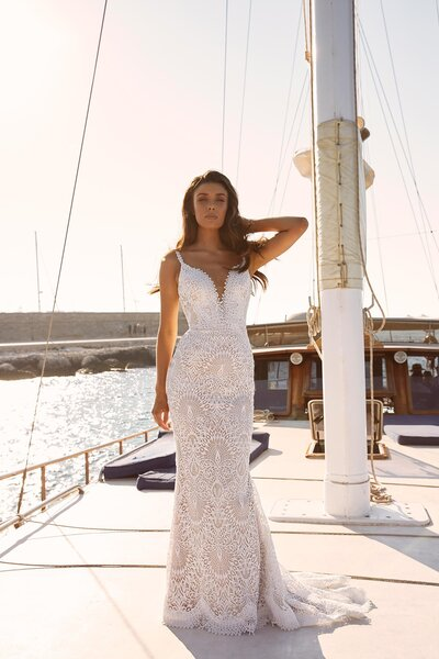 Far away from land and water bound, Marley is the goddess of sun and sea. Leave lavish gowns behind as Madi Lane brings you drama-free Marley. She is for the bride who is looking for a fiercely feminine silhouette which has a casual air about her. She is ideal for the laid back bride, which is reflected in her easy going design which comes in both ivory and warm mocha undertones. Her no fuss attitude is seen through her artesian spaghetti straps making her shoulders bare to the sun, her neckline dips before coming to a halt at her bodice and her back is humbly lowered and open. Marley's main feature is the exquisite scallop lace which keeps with her marine ideals. Fine prickled scalloping outlines her neckline and then enlarges as it makes its ways down to the hem before gently fluting into a minimal train. Marley's modern bride look simulates a low-key celebration or elopement, allowing her bride to really get down and enjoy her special day.