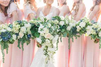 Bridesmaids holding florals