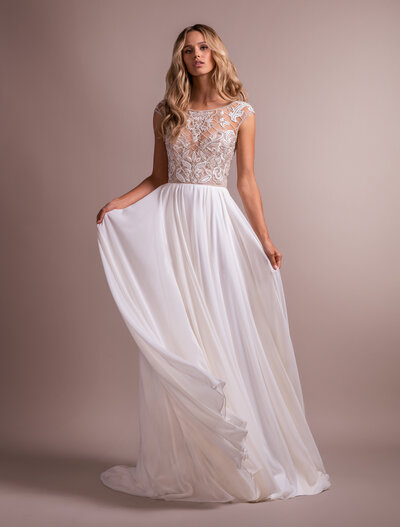 Hayley Paige bridal gown - Ivory chiffon A-line gown, beaded and embroidered cap sleeve bodice, jewel neckline front and back with cashmere sweetheart lining, flowing chiffon A-line skirt.