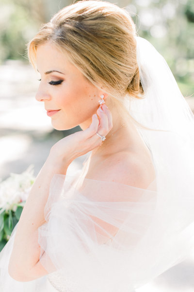 bridal portrait close up of bride focusing on the intimate details of her hair and jewelry in