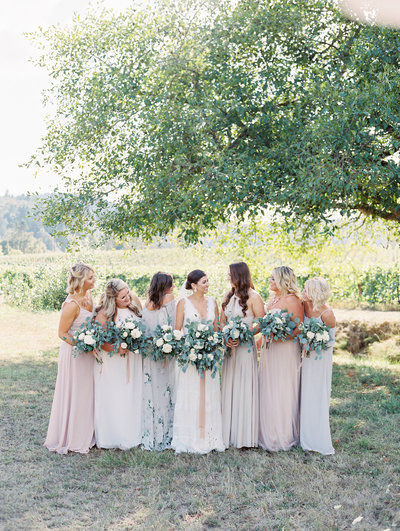 group photo of a bride with her bridesmaids
