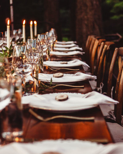 candlelight dinner place settings at rustic backyard wedding in Oregon