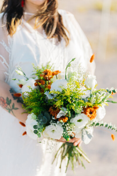 bright bouquet held by a bride