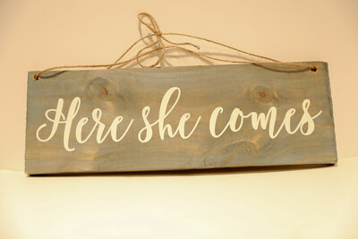 Here She Comes Sign