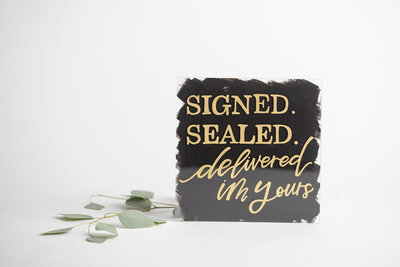 Signed, Sealed, Delivered, I'm Yours Black Acrylic Sign