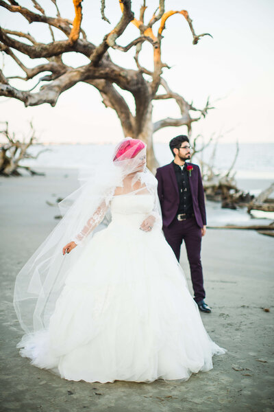 Sunset Wedding on Driftwood Beach in Jekyll Island - Izzy and Co.