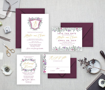 watercolor wedding invitations in shades of purple  with simple watercolor crest and monogram