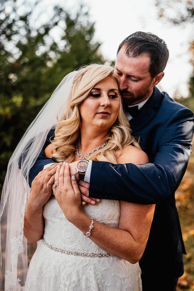 A bride and groom share a loving embrace