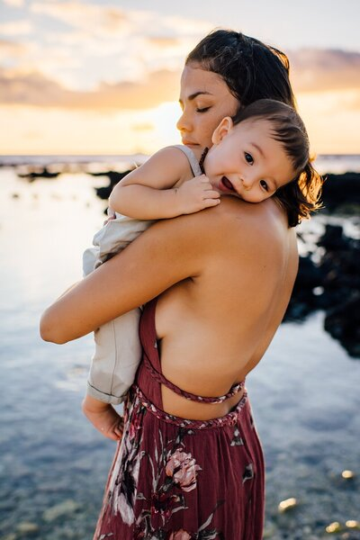 mom and son at sunset in big island hawaii