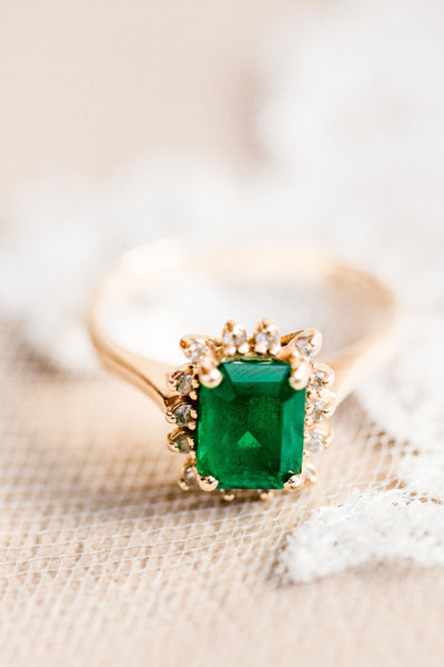 Emerald ring on a bridal veil