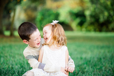A young brother and sister laugh together in Wauchula, Florida.