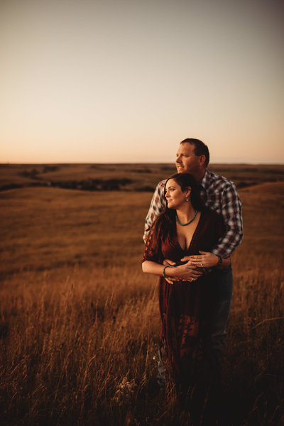 Nebraska couple hold onto each other during engagement session near Lincoln, Nebraska | Native Roaming