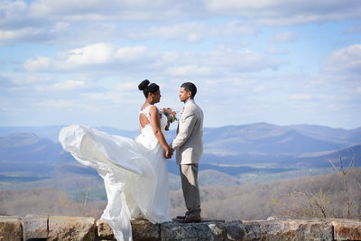Bride and Groom at a mountain overlook during their mountain elopement