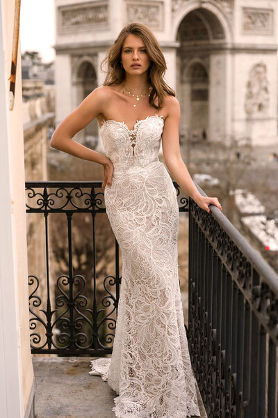 Ivy is truly an individual. Unique in her bold twisted twine lace of paisley petals, she is the first of her kind and may just be the only gown for the bride who is part romantic part diva. For flattering femininity opt for the detachable dappled sleevelets that sit off the shoulder and can be removed with the simple snap of an invisible button to make a sleek statement.  The dappled effect repeats in what is little more than a symbolically plunging sweetheart bust line which, only hinting at the revelation of flesh, leaves almost everything to the imagination. Ivy gives in to the illusion of bare skin as she turns to walk away and a composite back is revealed: partly covered, partly exposed, both supportive and low. A lace train that naturally drapes and billows in ballooning swathes collects behind her and her final impression is the same as her first – one of sheer luxury.