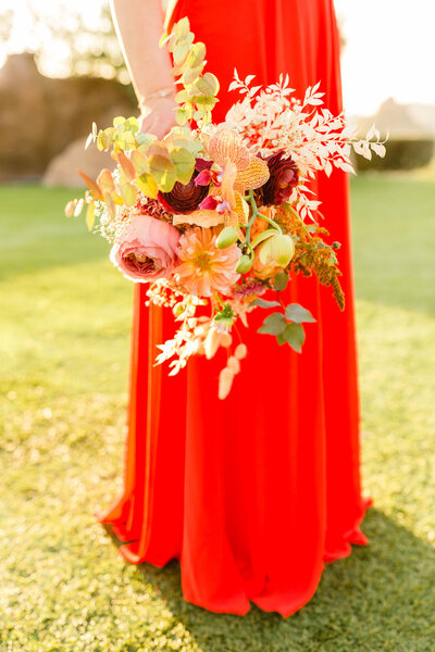 Bridesmaid holding bouquet of flower in Orange County, California. Wedding photo taken by Cheers Babe Photo.
