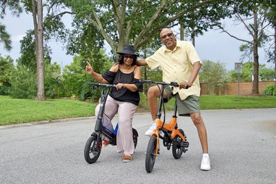 Married couple enjoying a scenic ride on there Blue Go-Bike M3 and Orange Go-Bike M4