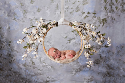 newborn on swing