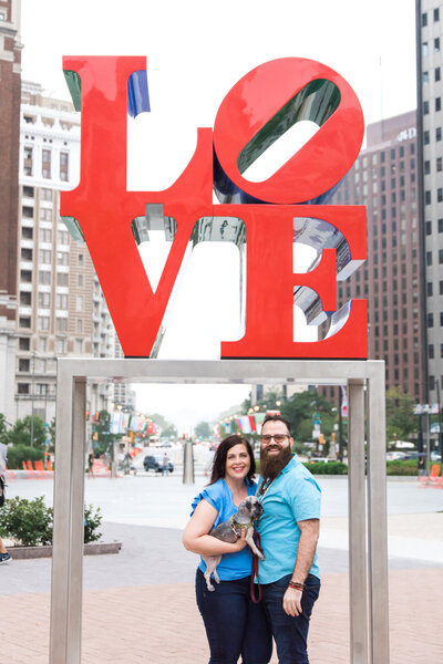 Couple in front of Love statue in Philadelphia