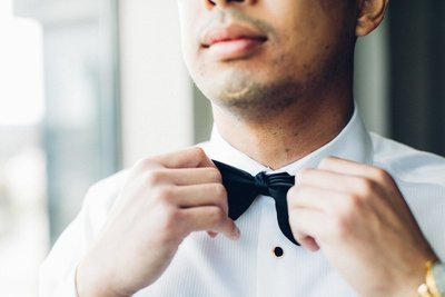 Baltimore Groom tying bow tie