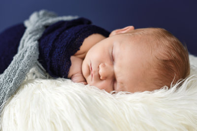 Beautiful Mississippi Newborn Photography: newborn boy wrapped in navy and gray