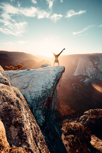 man-doing-hand-stand-on-mountain-2387866