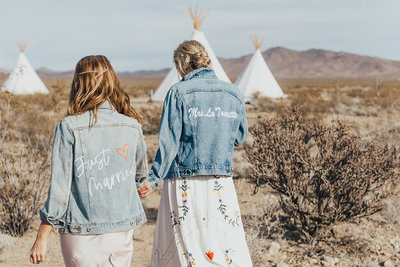 two women walking and wearing embroidered jean jackets
