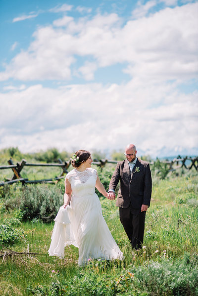 bride and groom walking jackson hole wedding