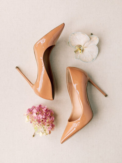 Flat lay detail of brides shoes with orchid and blush florals Close up of quiet moment between bride and groom on their wedding day by Blue Mountains Wedding Photographer Joshua Witheford
