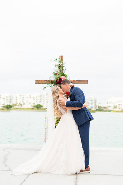 Bride and Groom kiss at altar.