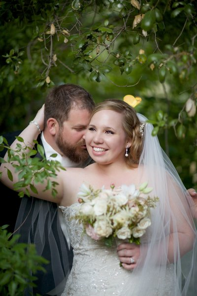 Bride and Groom in trees at Temecula Creek Inn