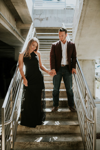 Couple standing on the stairs for their engagement photos at Crystal Bridges Museum of Art in Bentonville, Arkansas