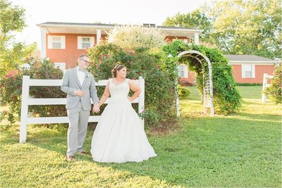 sunset photo of bride and groom looking away at Knoxville Wedding Venue Colonial Estates