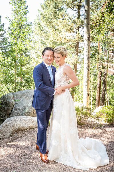 A Bride and Groom Embrace at Cloud Camp, Broadmoor